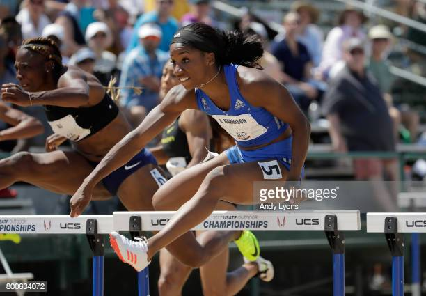 Kendra Harrison clears a hurdle on the way to victory in the Women's 100 Meter Hurdle Final during Day 3 of the 2017 USA Track Field Championships at...