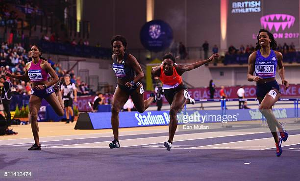 Kendra Harrison of the United States crosses the line to win the the Women's 60 metres hurdles final ahead of Kristi Castlin of the United States...