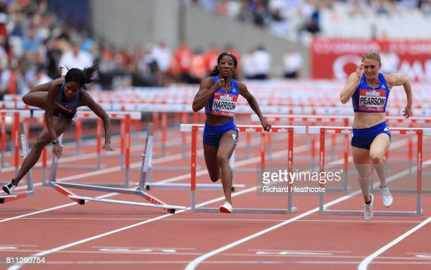 Kendra Harrison of the United States leads Sally Pearson over the final hurdle as Jasmin Stowers of the United States craahes into her hurdle during...