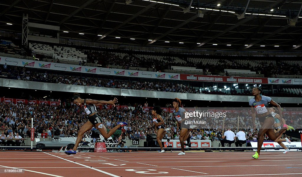 Kendra Harrison of The USA dips for the line in the womens 100m hurdles during Day One of the Muller Anniversary Games at The Stadium - Queen Elizabeth Olympic Park on July 22, 2016 in London, England.