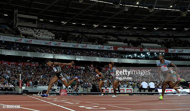Kendra Harrison of The USA dips for the line in the womens 100m hurdles during Day One of the Muller Anniversary Games at The Stadium Queen Elizabeth...