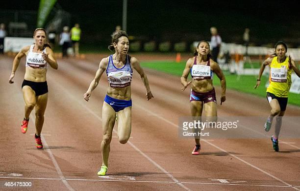 Kendra Hubbard, Chisato Fukushima, Michelle Cutmore and Zaidatul Husni Zulkifli compete in the women's 100 metre final during the Queensland Track...