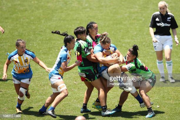 Kendra Reynolds of Bay of Plenty is brought down against Manawatu during the TECT National Sevens tournament at Tauranga Domain on December 16 2018...