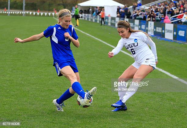 Kendra Stauffer of Grand Valley State University blocks a kick by Erin Russell of Western Washington University during the Division II Women's Soccer...