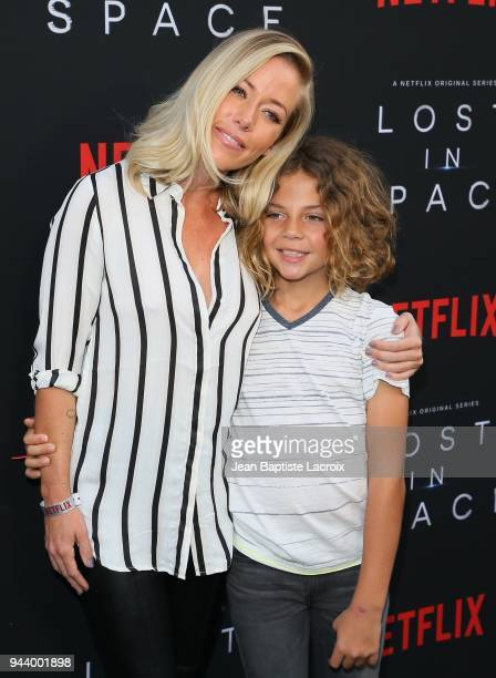 Kendra Wilkinson and Hank Baskett IV attend the premiere of Netflix's 'Lost In Space' Season 1 on April 9 2018 in Los Angeles California