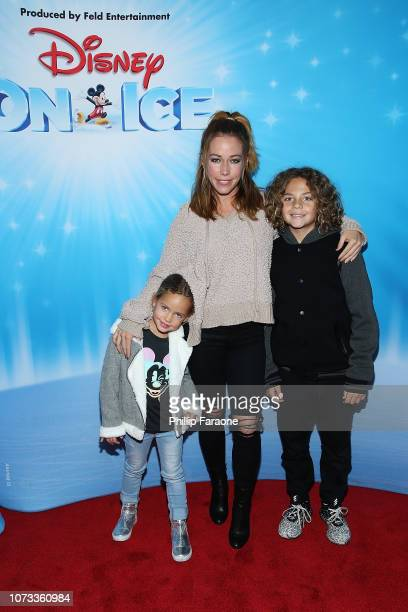 Kendra Wilkinson and her children attend Disney On Ice Presents 'Dare To Dream' at Staples Center on December 14 2018 in Los Angeles California