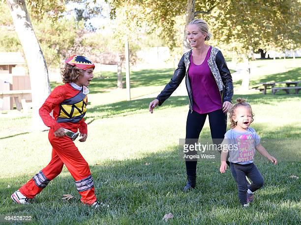 Kendra Wilkinson plays with her kids Hank Baskett Baskett IV and Alijah Baskett in Power Rangers Halloween Costumes on October 26 2015 in Calabasas...