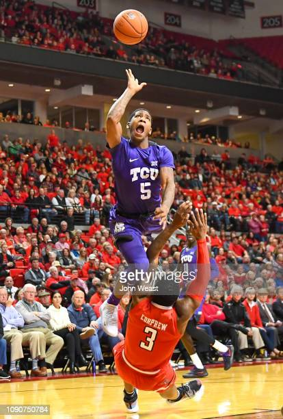 Kendric Davis of the TCU Horned Frogs is called for the offensive foul against Deshawn Corprew of the Texas Tech Red Raiders during the second half...
