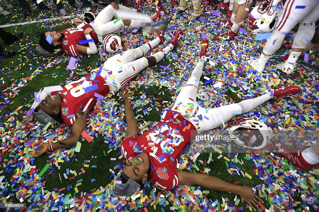 Kendric Pryor #27, Quintez Cephus #87, and Jazz Peavy #11 of the Wisconsin Badgers celebrate following the 81st Goodyear Cotton Bowl at AT&T Stadium on January 2, 2017 in Arlington, Texas. Wisconsin won 24-16.