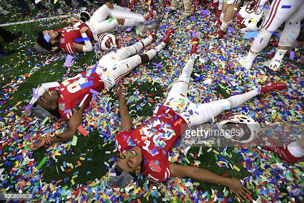 Kendric Pryor Quintez Cephus and Jazz Peavy of the Wisconsin Badgers celebrate following the 81st Goodyear Cotton Bowl at ATT Stadium on January 2...