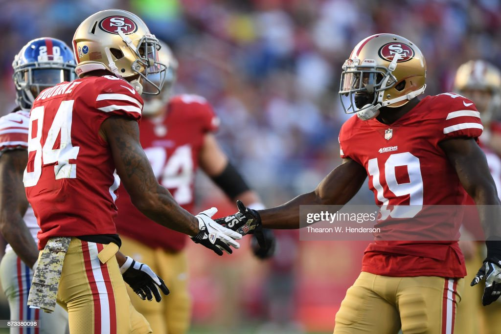 Kendrick Bourne #84 and Aldrick Robinson #19 of the San Francisco 49ers react after a play against the New York Giants during their NFL game at Levi's Stadium on November 12, 2017 in Santa Clara, California.