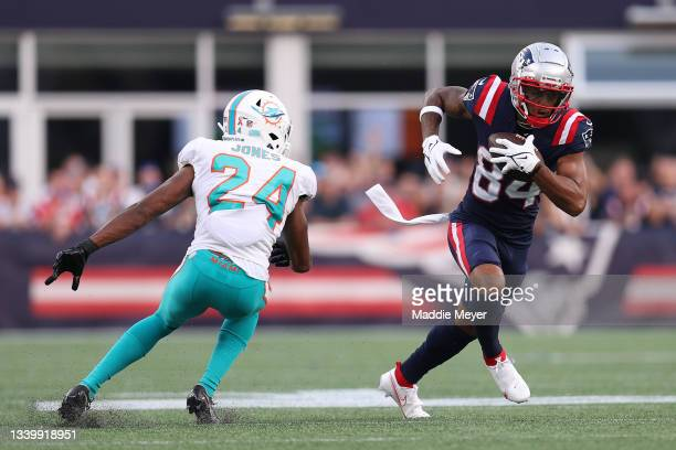 Kendrick Bourne of the New England Patriots runs with the ball after a reception against Byron Jones of the Miami Dolphins at Gillette Stadium on...