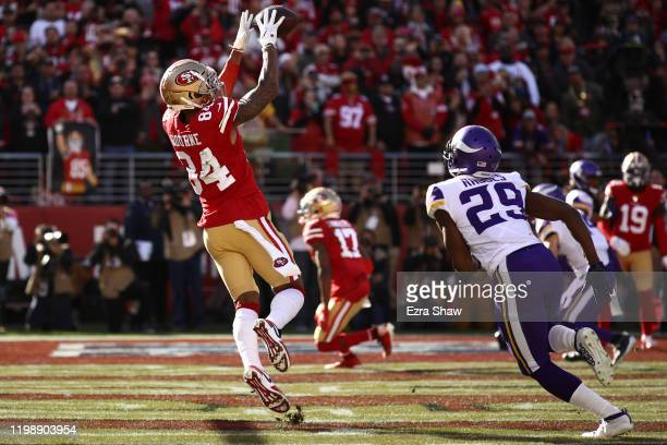 Kendrick Bourne of the San Francisco 49ers catches a touchdown pass during the first quarter against the Minnesota Vikings during the NFC Divisional...