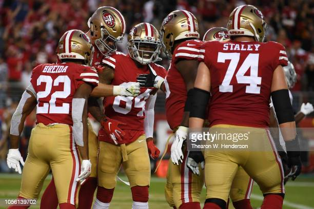 Kendrick Bourne of the San Francisco 49ers celebrates after a fouryard touchdown against the Oakland Raiders during their NFL game at Levi's Stadium...