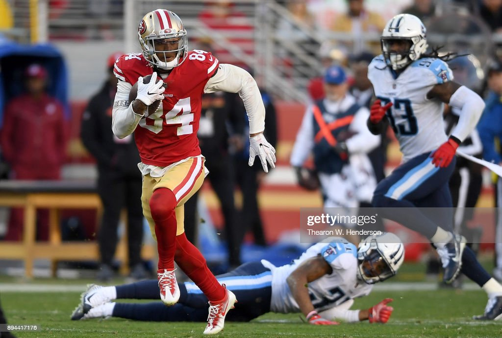Kendrick Bourne #84 of the San Francisco 49ers gains 54 yards on a pass play against the Tennessee Titans during their NFL football game at Levi's Stadium on December 17, 2017 in Santa Clara, California.