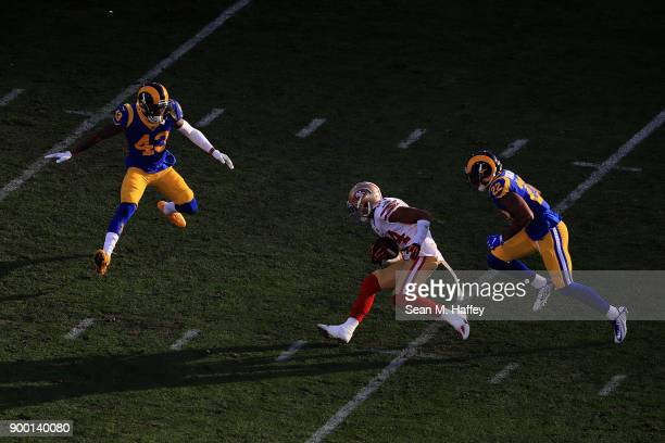 Kendrick Bourne of the San Francisco 49ers is chased by John Johnson and Trumaine Johnson of the Los Angeles Rams during the second half of a game at...
