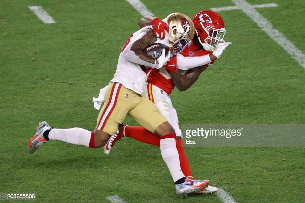 Kendrick Bourne of the San Francisco 49ers is tackled by Charvarius Ward of the Kansas City Chiefs during the third quarter in Super Bowl LIV at Hard...