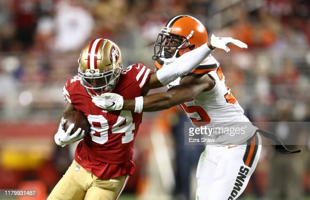 Kendrick Bourne of the San Francisco 49ers is tackled by Jermaine Whitehead of the Cleveland Browns at Levi's Stadium on October 07 2019 in Santa...