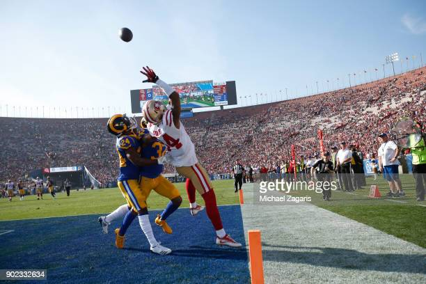 Kendrick Bourne of the San Francisco 49ers leaps for a pass as Blake Countess of the Los Angeles Rams defends during the game at Los Angeles Memorial...