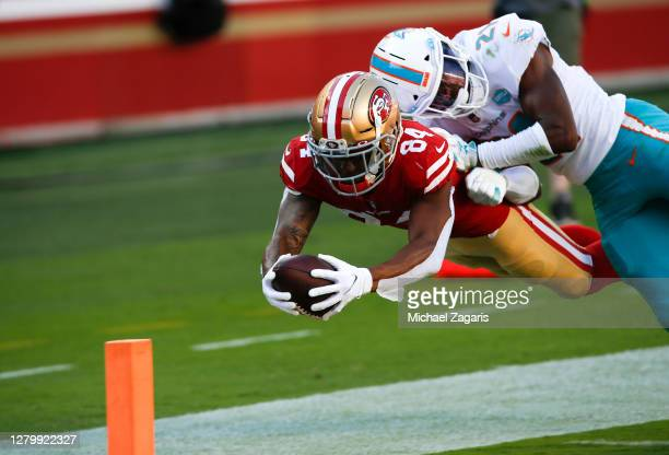 Kendrick Bourne of the San Francisco 49ers runs after making a catch for a 19-yard touchdown during the game against the Miami Dolphins at Levi's...