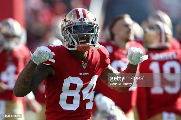 Kendrick Bourne of the San Francisco 49ers runs out of the tunnel prior to the NFC Divisional Round Playoff game against the Minnesota Vikings at...