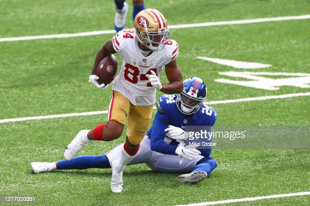 Kendrick Bourne of the San Francisco 49ers runs with the ball after the catch past James Bradberry of the New York Giants at MetLife Stadium on...