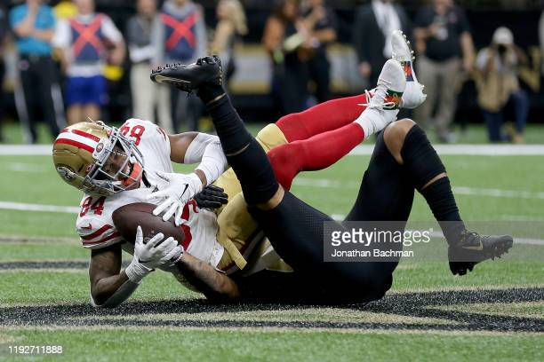 Kendrick Bourne of the San Francisco 49ers scores a 6 yard touchdown against Marshon Lattimore of the New Orleans Saints during the first quarter in...