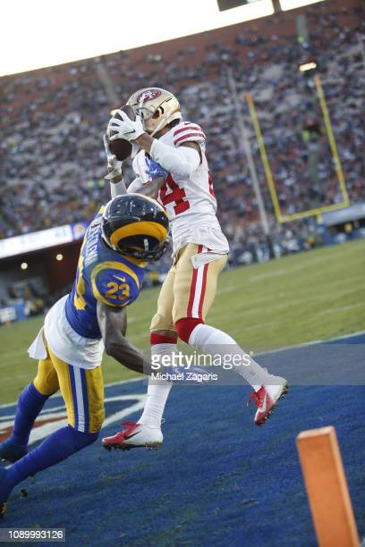 Kendrick Bourne of the San Francisco 49ers scores on a 2yard touchdown reception during the game against the Los Angeles Rams at the LA Memorial...