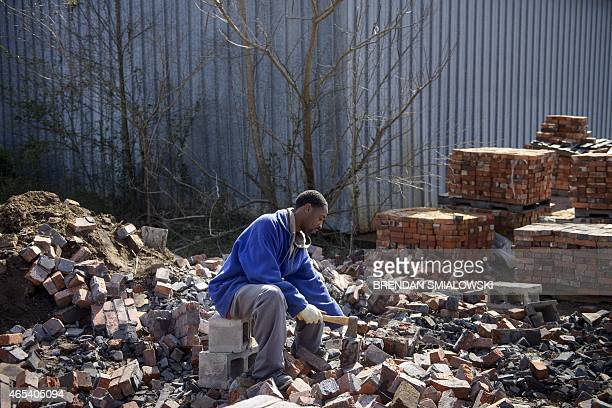 Kendrick Green cleans bricks as they are reclaimed from a demolition site on March 6 2015 in Selma Alabama March 7 will mark the 50th anniversary of...