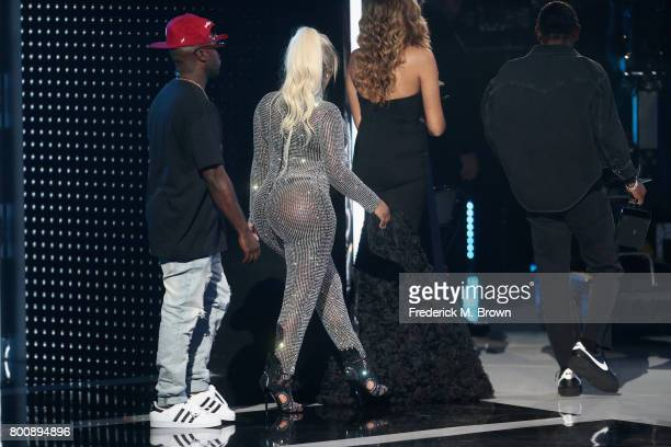 Kendrick Lamar accepts the Best Male Hip Hop Artist award from Havoc and Lil' Kim onstage at 2017 BET Awards at Microsoft Theater on June 25 2017 in...
