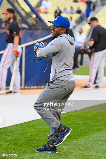 Kendrick Lamar warms up before throwing out the ceremonial first pitch at a baseball game between the San Francisco Giants and the Los Angeles...