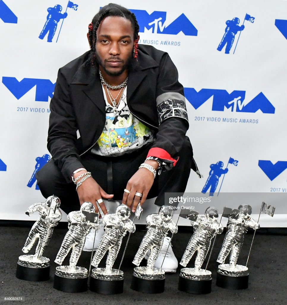 Kendrick Lamar, winner of Video of the Year, Best Hip Hop, Best Cinematography, Best Direction, Best Art Direction, Best Visual Effects for 'Humble', poses in the press room during the 2017 MTV Video Music Awards at The Forum on August 27, 2017 in Inglewood, California.