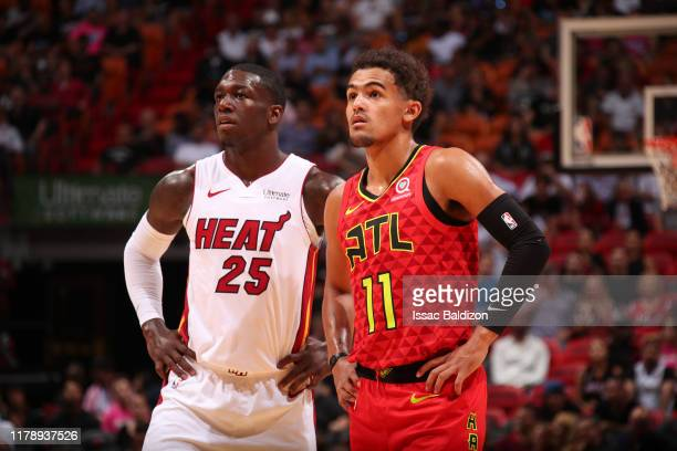 Kendrick Nunn of the Miami Heat and Trae Young of the Atlanta Hawks look on during the game on October 29 2019 at American Airlines Arena in Miami...