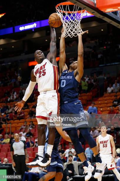 Kendrick Nunn of the Miami Heat attempts a dunk against De'Anthony Melton of the Memphis Grizzlies during the second half at American Airlines Arena...