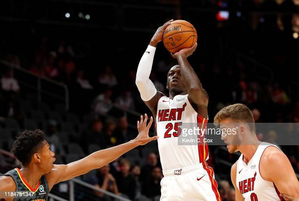 Kendrick Nunn of the Miami Heat attempts a shot against De'Andre Hunter of the Atlanta Hawks in the first half at State Farm Arena on October 31 2019...