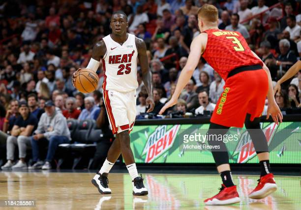Kendrick Nunn of the Miami Heat dribbles with the ball against Kevin Huerter of the Atlanta Hawks during the second half at American Airlines Arena...