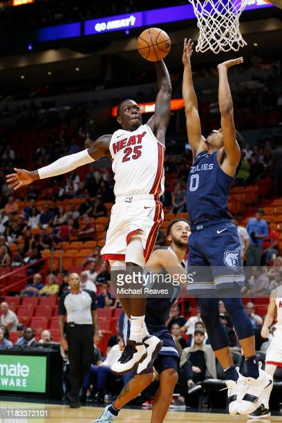 Kendrick Nunn of the Miami Heat goes up for a dunk against De'Anthony Melton of the Memphis Grizzlies during the second half at American Airlines...