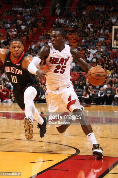 Kendrick Nunn of the Miami Heat handles the ball against the Houston Rockets during a preseason game on October 18 2019 at American Airlines Arena in...