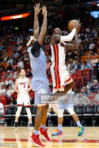 Kendrick Nunn of the Miami Heat shoots over James Johnson of the Minnesota Timberwolves during the second half at American Airlines Arena on February...