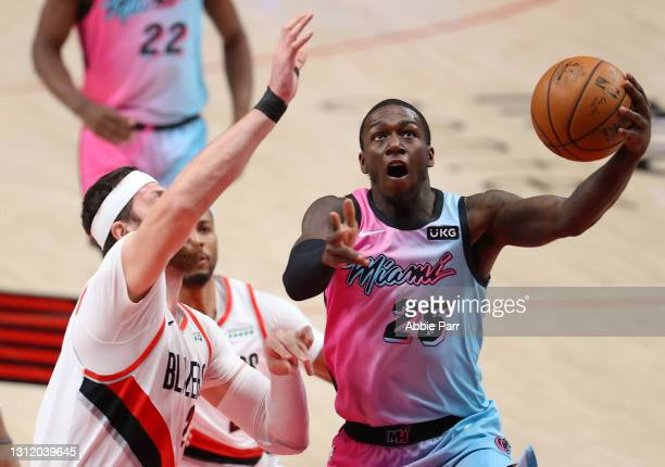 Kendrick Nunn of the Miami Heat takes a shot against Jusuf Nurkic of the Portland Trail Blazers in the first quarter at Moda Center on April 11, 2021...