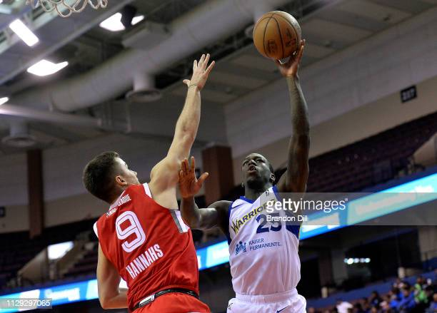 Kendrick Nunn of the Santa Cruz Warriors shoots against Dusty Hannahs of the Memphis Hustle at Landers Center in an NBA GLeague game on March 8 2019...
