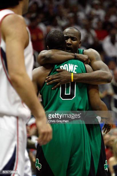 Kendrick Perkins hugs Leon Powe of the Boston Celtics after being fouled by the Atlanta Hawks in Game Six of the Eastern Conference Quarterfinals...