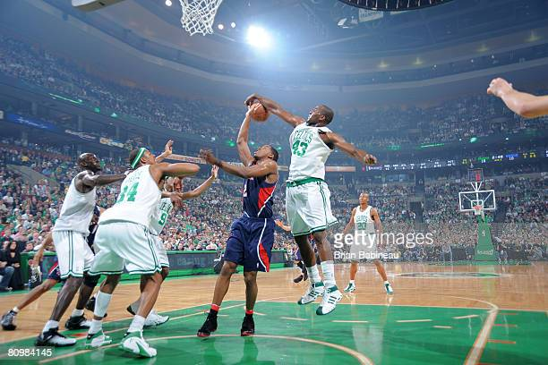Kendrick Perkins of the Boston Celtics blocks a shot attempt by Joe Johnson of the Atlanta Hawks in Game Seven of the Eastern Conference...