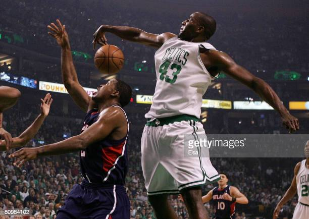 Kendrick Perkins of the Boston Celtics blocks a shot by Joe Johnson of the Atlanta Hawks during Game Seven of the Eastern Conference Quarterfinals...