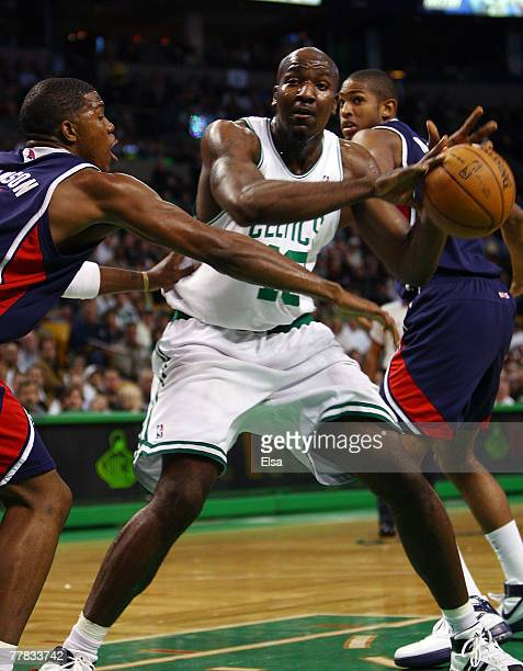 Kendrick Perkins of the Boston Celtics loses the ball as Joe Johnson of the Atlanta Hawks defends on November 9 2007 at the TD Banknorth Garden in...
