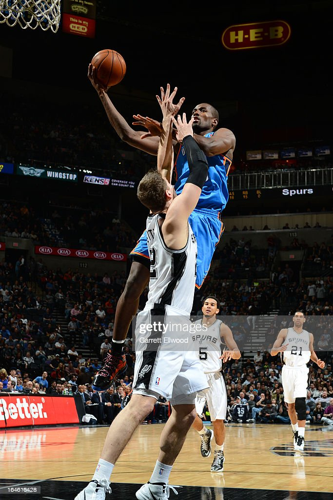 Kendrick Perkins #5 of the Oklahoma City Thunder drives to the basket against the San Antonio Spurs on March 11, 2013 at the AT&T Center in San Antonio, Texas.