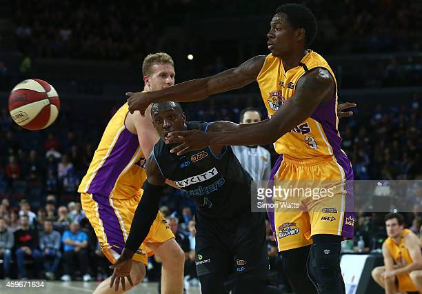 Kendrick Perry of the Kings passes under pressure from Cedric Jackson of the Breakers during the round eight NBL match between New Zealand Breakers...