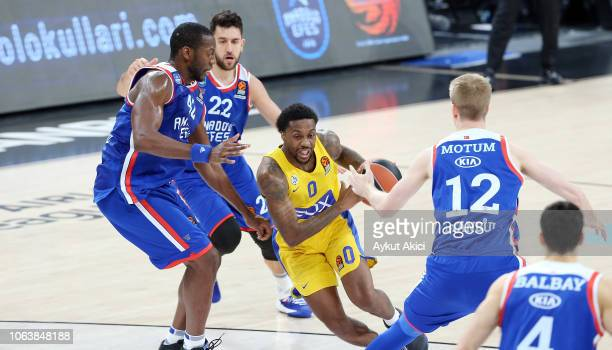 Kendrick Ray, #0 of Maccabi Fox Tel Aviv competes with Brock Motum, #12 of Anadolu Efes Istanbul during the 2018/2019 Turkish Airlines EuroLeague...