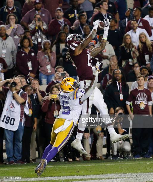 Kendrick Rogers of the Texas AM Aggies catches a pass for a touchdown in overtime as Kary Vincent Jr #5 of the LSU Tigers defends as at Kyle Field on...