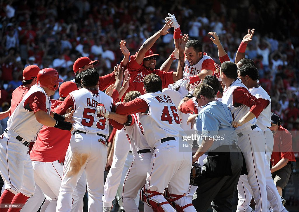 Kendry Morales #8 of the Los Angeles Angels celebrates his grand slam homerun to win the game 5-1 over the Seattle Mariners during the bottom of the ninth inning at Angel Stadium on May 29, 2010 in Anaheim, California.